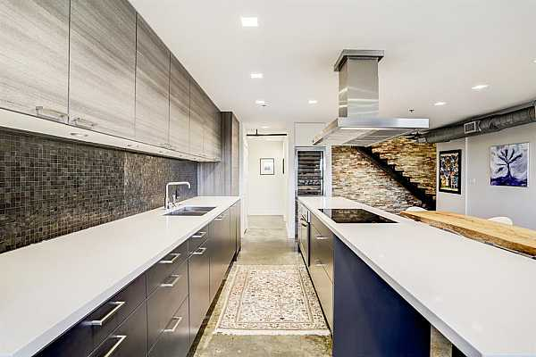 Photo #8 Simple, cool, white quartz counters with an abundance of prep space!