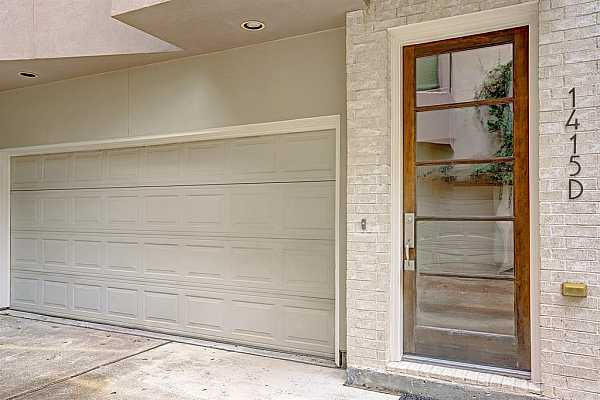 Photo #3 Spacious 2 car garage with a modern front door.