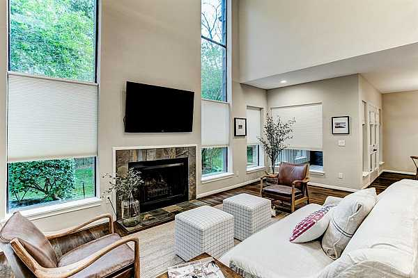 Photo #5 This beautiful Living Room (19 x 14) offers a two-story living space. The floor to ceiling windows fill the space with natural light and greenspace views. The Living Room is open to the formal dining area and a cozy study is located off this room as well.