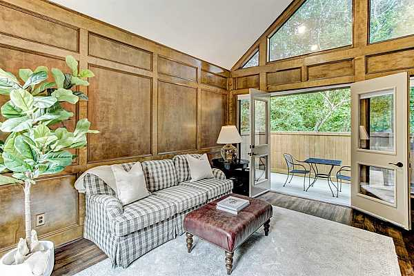 Photo #9 The beautiful Study (14x11) might be your favorite room! Wood paneling, multiple windows, green views and built-ins make this room a winner! This space could alternate as a cozy den or workplace. French doors open to a new deck as well as a new fence by current owner.