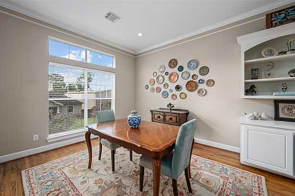 Photo #9 Formal dining room attaches and opens to the kitchen and living, making it the perfect spot to entertain guests.