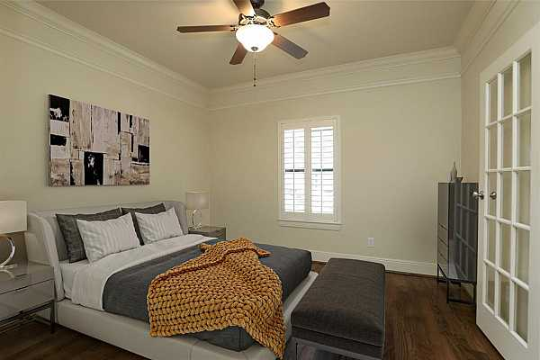 Photo #11 secondary bedroom downstairs with french doors, could be used as a study as well