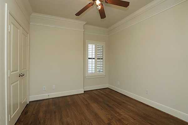 Photo #8 secondary bedroom downstairs with double closet doors for easy access