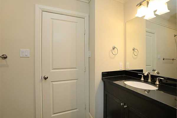 Photo #9 Jack and Jill bathroom between the two downstairs bedrooms