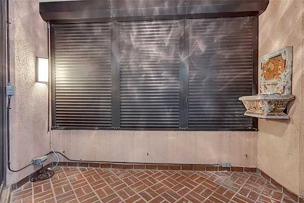Photo #12 Electric storm shutters for balcony Close with Electric Storm Shutters for Storm Protection.