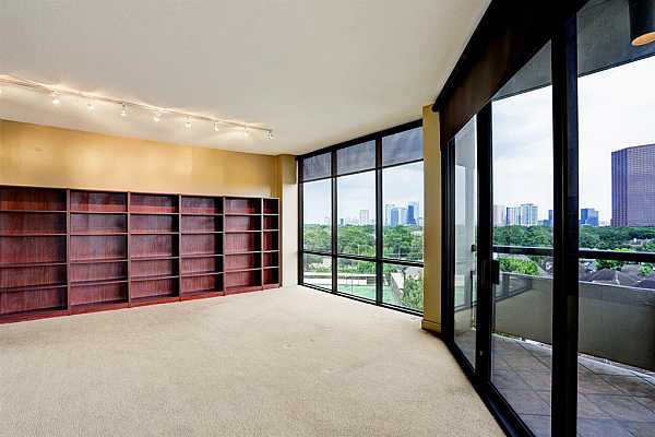 Photo #5 The living room has two sets of built ins to accommodate your books or other collections
