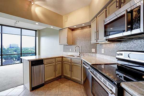 Photo #9 The kitchen has been updated, and has granite countertops, stainless appliances, and plenty of storage.