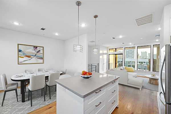 Photo #1 Welcome to the perfect open floor plan for entertaining and picturesque views of downtown Houston. *Virtually Staged