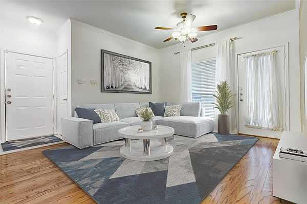 Photo #3 Virtually staged. Living area with access to balcony with views of courtyard and pool.