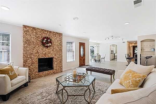 Photo #1 Welcome to 13420 Trail Hollow! Great LOCATION and MOTIVATED SELLER! With over $90,000 of UPGRADES, including recent COPPER plumbing!  This updated contemporary unit is filled with natural light and courtyard views!