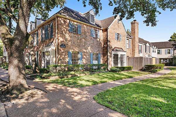 Photo #3 This unit is incredibly spacious, and has tons of character! Admire the brick exterior with blue shutters.