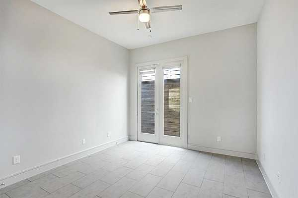 Photo #8 This room offer access to the side patio and features sleek tile flooring.