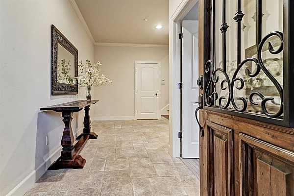 Photo #6 Welcome into this spacious foyer entry offering Elevator ready to Third floor, back door leading to a spacious two car garage that you can access to it from the back side of the house.