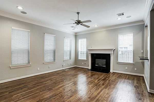 Photo #5 Lots of natural light in the living room with a gas fireplace.