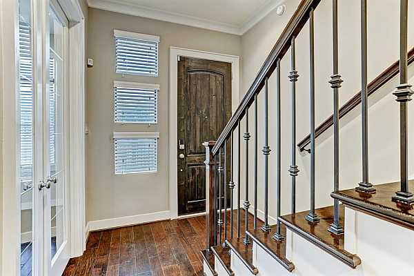 Photo #8 Entry with wood floors, first floor room, plus an additional bonus space.