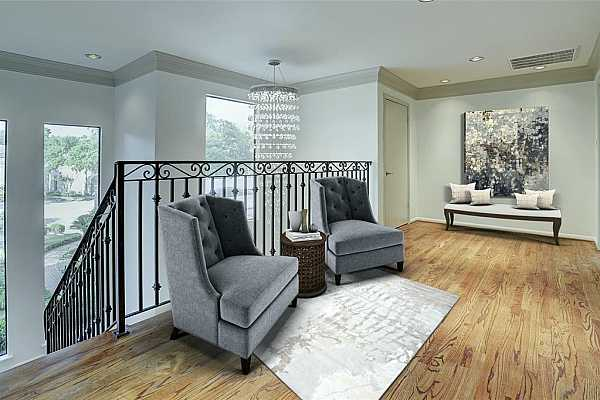 Photo #10 The virtually staged landing with hardwood floors is quite large.  There are lots of possibilities for this space.  Currently set up as a sitting area, it could also be set up an upstairs den.  The landing leads to the 2 secondary bedrooms with en-suite baths.