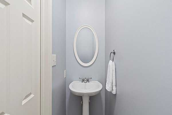 Photo #11 A convenient half bath is located on the second floor.