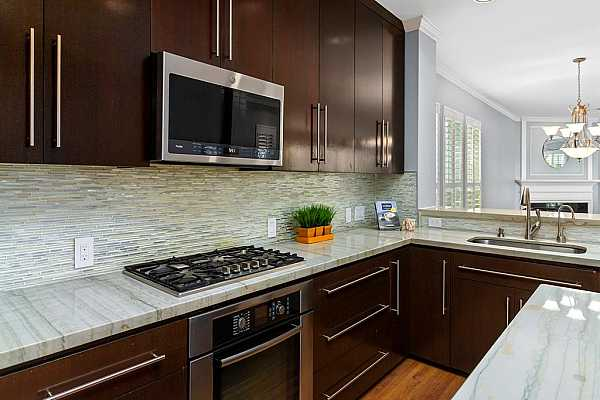 Photo #7 An impressive kitchen boasts quartzite countertops and gorgeous cabinets and soft close drawers.