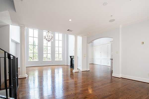 Photo #10 The sweeping two-story windows in the formal living provide an extraordinary view over the private estates of River Oaks, Houston
