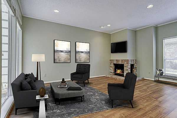 Photo #4 Downstairs living room has hardwood floors and wood burning fireplace and recessed lighting.