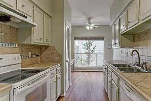 Photo #7 The kitchen has stone tile counters and backsplash and nice breakfast area.