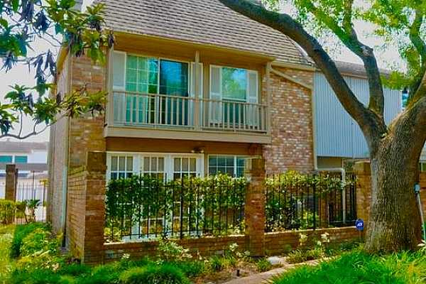 Photo #1 This charming home offers an enchanting New Orleanean brick courtyard. Shaded by a magnificent elm. bedrooms which overlook the landscaped green from a private balcony.