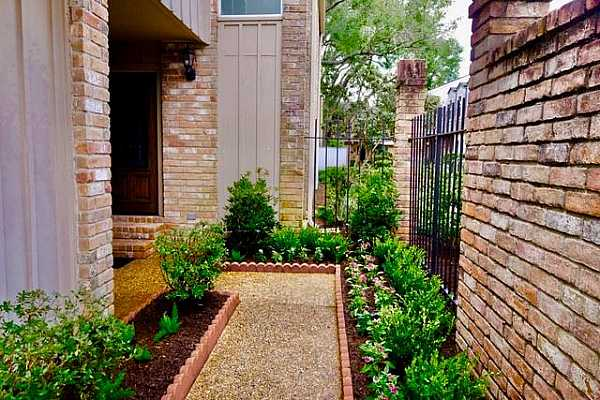 Photo #5 New landscaping in July of 2021 leads to your entry and is fully sprinklered. Boxwood, azaleas, sweet olive and flowers grace your walkway.