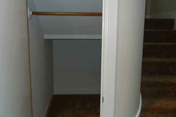 Photo #12 Coat and luggage closet under stairs
