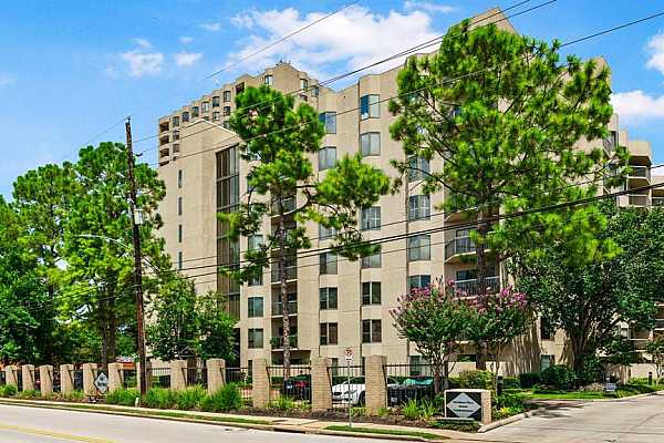 Photo #4 Woodway Place CondominiumsFront Courtesy StaffOn Site ManagementGarage Covered Parking with Private Gate Access24 Hr Access ControlSpectacular Pool & Hot TubCabana Grill AreaTennis CourtsDoggie ParkFitness CenterTanglewood Park directly across the street