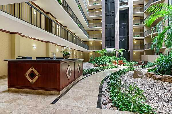 Photo #6 View of the concierge desk and lovely atrium.  Two spacious elevators.