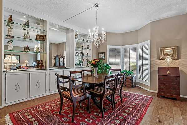 Photo #8 Lovely builtins back wall of dining has recessed lighting and storage space galore for all your china and serving pieces.