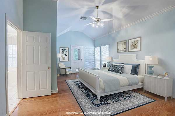 Photo #11 Large primary bedroom.  High ceilings and sitting area.