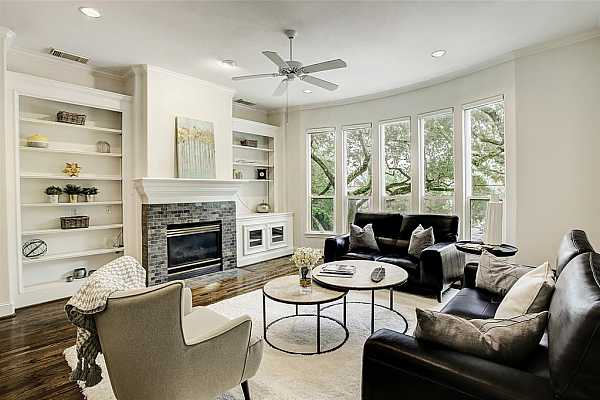 Photo #4 Extra large living space with lots of natural light looking through the trees onto the neighborhood.