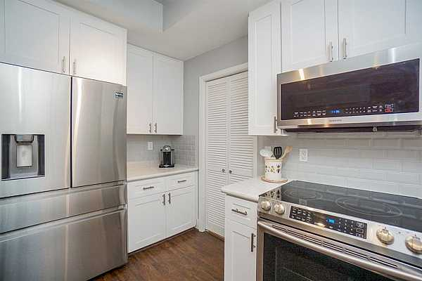 Photo #10 Entire townhome has Samsung appliances: refrigerator, microwave, dishwasher, stove top/oven combo, washer and dryer.