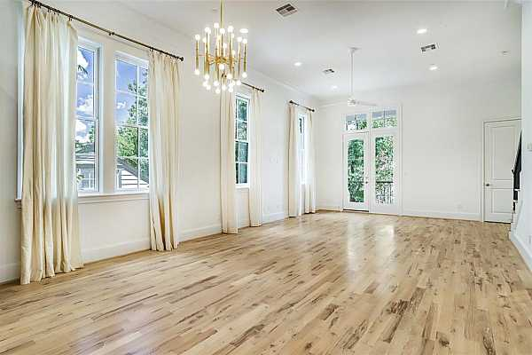 Photo #11 2nd floor living room view looking towards the homes fabulous kitchen.  Open spaces, light bright happy home.