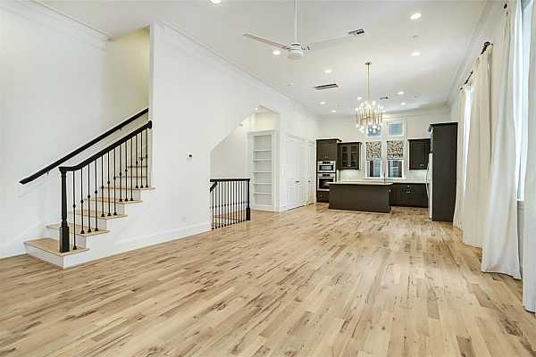 Photo #12 Granite Island Kitchen, Brookhaven Soft Close Cabinets and Drawers, Miele Appliances including a 5 burner gas cooktop, Oven, built in microwave and vent hood and dishwasher.  White Kitchen Aid French Door refrigerator.  Subway Tile Backsplash, Under Counter Lighting.  Walk-in pantry.