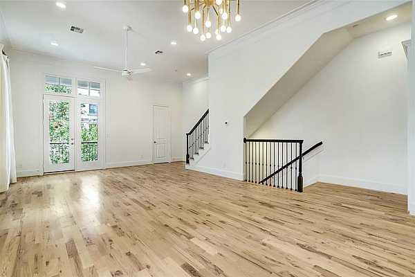 Photo #10 2nd floor Dining Room, Living Room area view.  The French Doors open to the homes 2nd floor private deck.