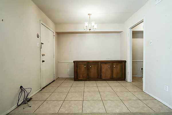 Photo #7 Dining room with door to private patio and gate to back-door covered parking.