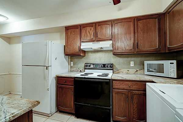 Photo #9 Kitchen with lots of storage.