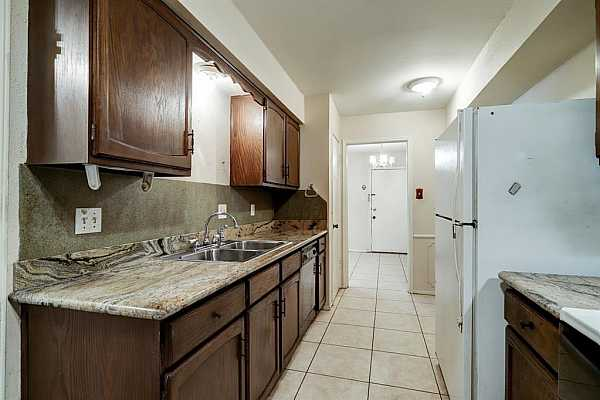 Photo #10 View from the kitchen through the dining room to the back door. Space for a small table beyond the refrigerator/freezer.