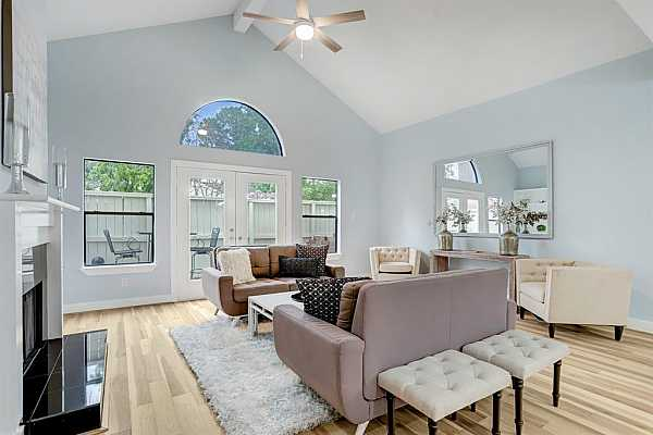 Photo #1 The Living Area of this Beautiful 3 Bedroom, 2.5 Bath Townhome is Open and Bright!  This Spacious Living Area Features Natural Hickory Wide Plank Hardwood Floors and Double Patio Doors with Arched Transom Above.