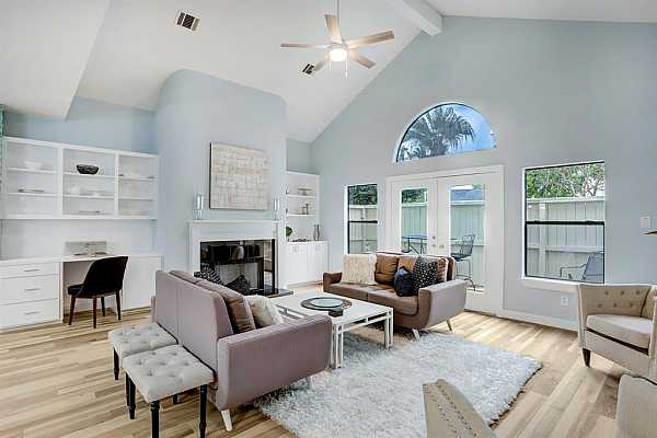 Photo #3 Additional Amenities in the Living Area include Fireplace with Gas Connection, Built in Desk with Cabinets, 2 Story Cathedral Beamed Ceiing, Built in Cabinets and Bookshelves, Ceiling Fan with Light, Soft Contemporary Rounded Wall, and Fresh Designer Paint.