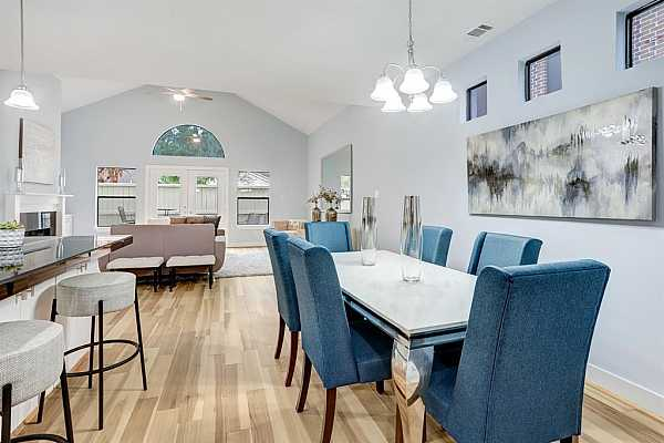 Photo #8 The Dining Area is open to the Kitchen and Living Area and Offers a Brushed Nickel Chandelier.