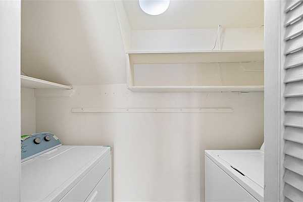 Photo #10 Laundry/utility room has handy shelving and storage and new washer and dryer stays with townhome.
