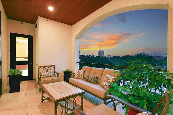 Photo #7 The serene balcony is beautifully appointed with tile flooring and a wide arched opening to enjoy the neighborhood areas surrounding Chateau Ten and views of the city.