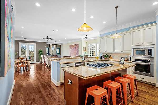 Photo #5 A spacious kitchen with ample storage and room to entertain the family for the Summer or Holidays.