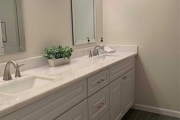 Photo #8 Gorgeous full bath includes marble countertop with double sinks.