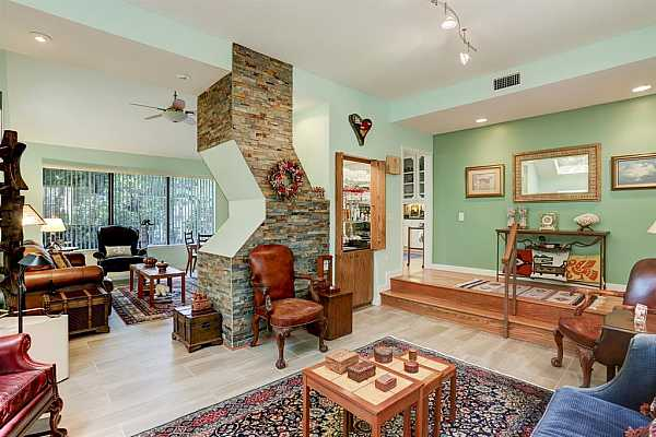 Photo #1 Totally updated!  Great flow for entertaining! Custom, wood-burning fireplace in den with accent chimney in living room.  Patio views from all windows.