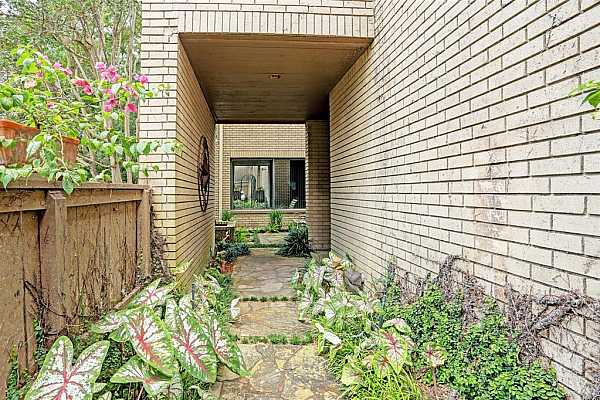 Photo #5 A gated and fenced entry into the garden pathway greets your guests.