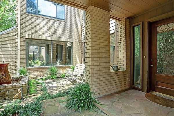 Photo #6 A covered entry leads to the front patio with fountain and seating area. A beveled glass door provides an attractive entrance to the  home.